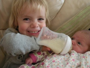 Sofia relishing the big sister role. How big is that bottle of expressed milk!?