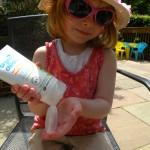 Sofia applying her suncream