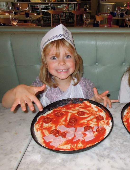 Sofia having lots of fun at a Pizza Express party